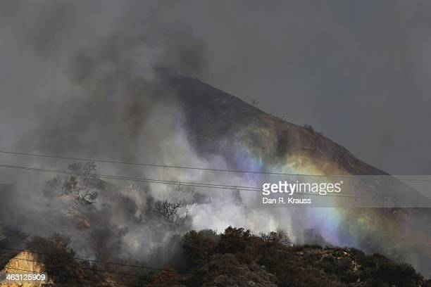 Planes work to control the wildfires in Azusa Calif as they burn through the hillsides on January 16 2014 in Azusa California Authorities have stated...