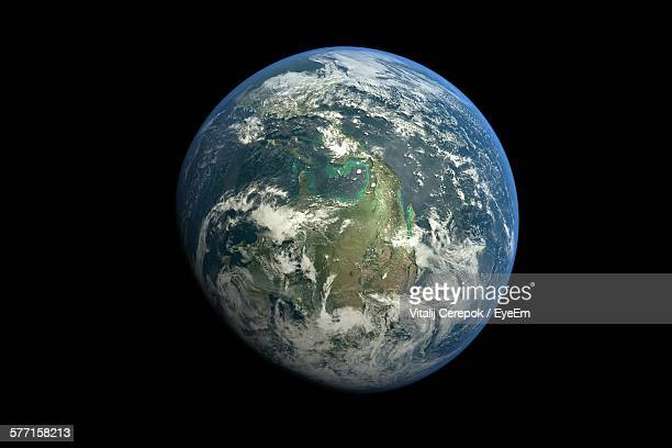 planet earth against black background - copy space stock-fotos und bilder