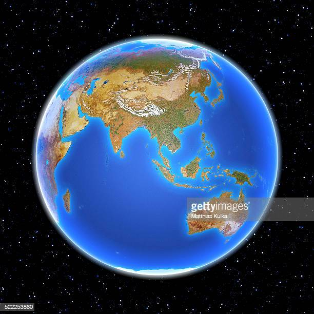 planet earth floating in space - asia pacífico fotografías e imágenes de stock