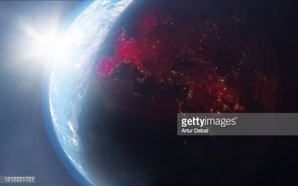 planet earth from outer space with coronavirus map expansion in europe. covid-19 in 2020. - physische geographie stock-fotos und bilder