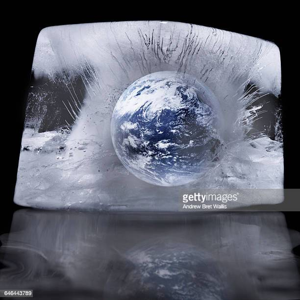 Planet earth frozen in a block of ice