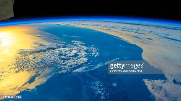 planet earth seen from space, creative view of the artist - image stock-fotos und bilder