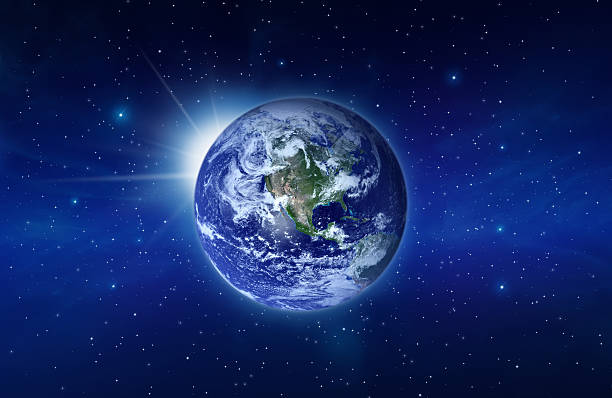 Planet Earth with Rising Sun behind