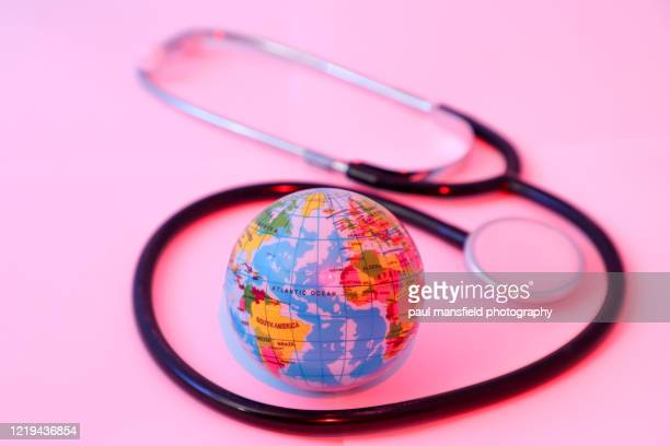 "planet earth with stethoscope - ""paul mansfield photography"" stock pictures, royalty-free photos & images"