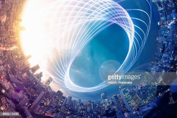 planet shape panorama cityscape with light trail at dusk - globale kommunikation stock-fotos und bilder
