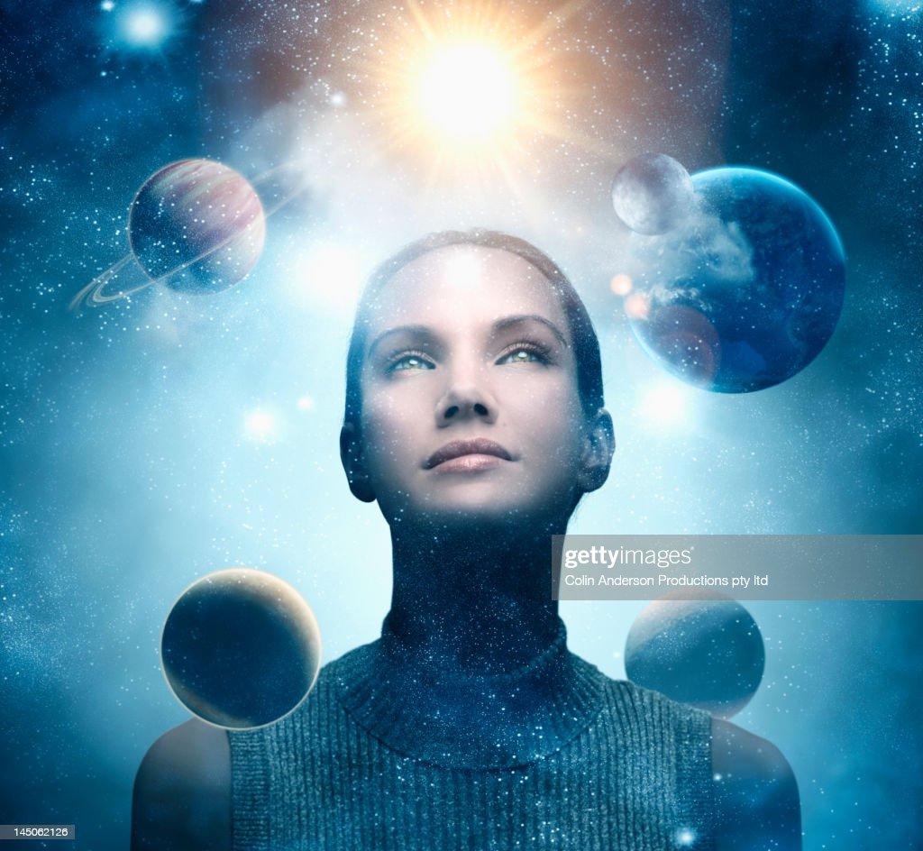 Planets orbiting around Pacific Islander woman's head : Stock Photo