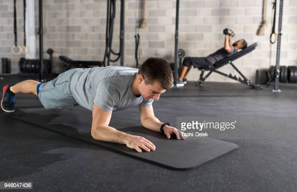 plank as good abdomen exercise - plank exercise stock pictures, royalty-free photos & images