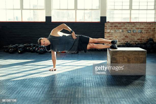 planking his way to fitness - plank exercise stock pictures, royalty-free photos & images