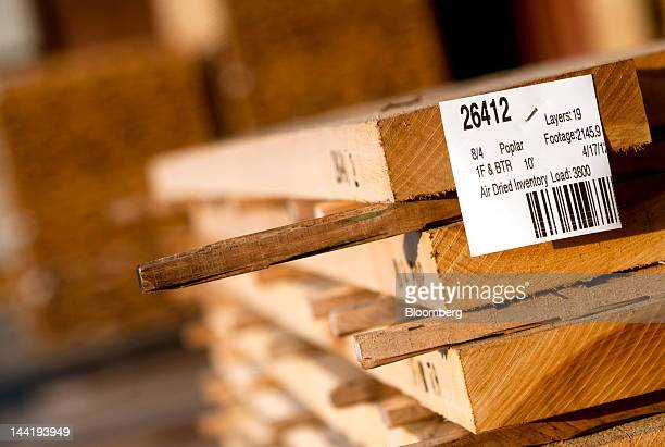 Planks of cut poplar sit to dry in bundles at Superior Hardwoods of Ohio Inc in Barlow Ohio US on Thursday May 10 2012 Superior Hardwoods of Ohio a...