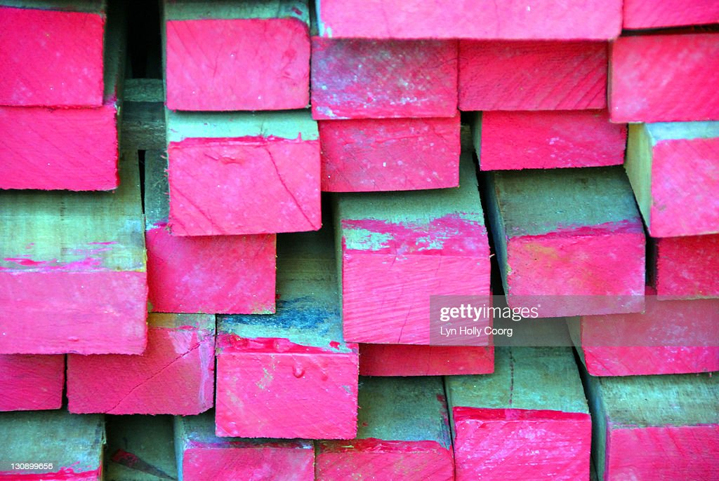 Planks of wood dipped in pink paint : Stock Photo