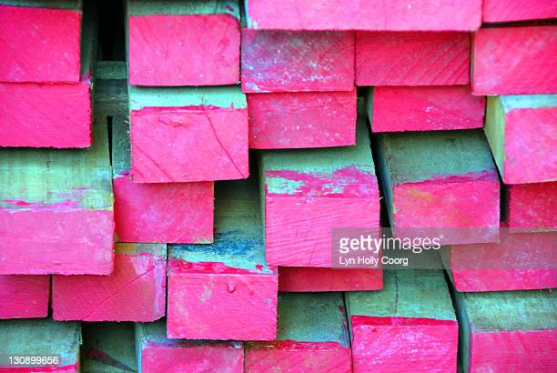 planks of wood dipped in pink paint - lyn holly coorg stock pictures, royalty-free photos & images