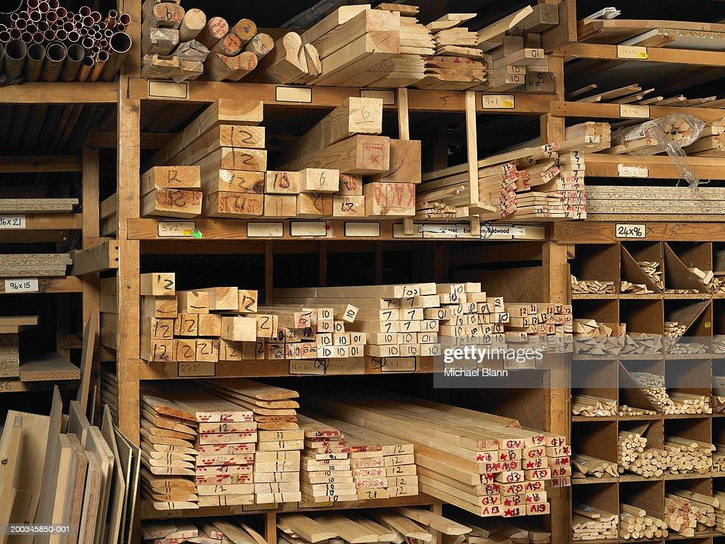 Planks of wood on shelves : Stock Photo