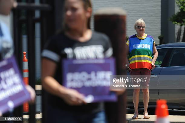 Planned Parenthood clinic escort is seen during a prolife rally outside the Planned Parenthood Reproductive Health Center on June 4 2019 in St Louis...