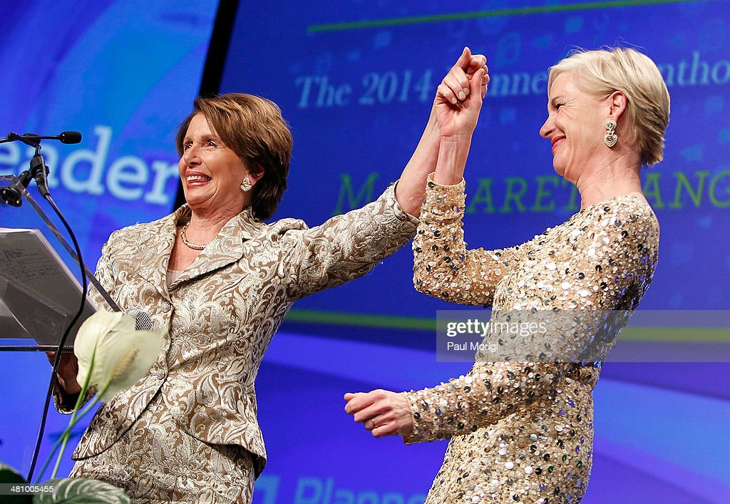 Planned Parenthood Federation of America President Cecile Richards (R) presents U.S. House Minority Leader Rep. Nancy Pelosi (D-CA) with the Margaret Sanger Award at the Planned Parenthood Federation Of America's 2014 Gala Awards Dinner at the Marriott Wardman Park Hotel on March 27, 2014 in Washington, DC.