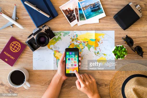 planning a travel with iphone - airbnb stock pictures, royalty-free photos & images