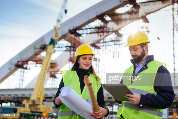 planning and teamwork in construction industry - civil engineering stock photos and pictures