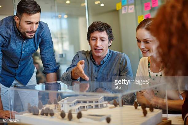 planning around their client's specifications - architectural model stock pictures, royalty-free photos & images
