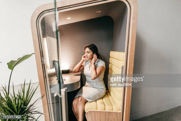 planning for a new world. multiethnic woman on her video chat with online  team - coworking stock pictures, royalty-free photos & images