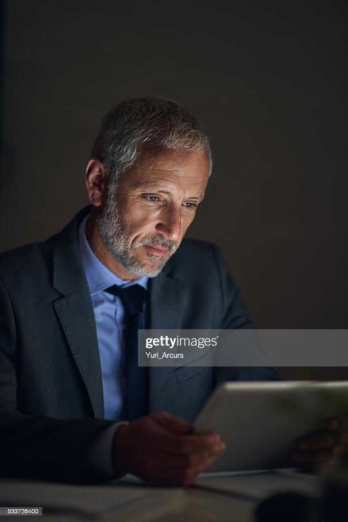 Planning late into the night : Foto stock