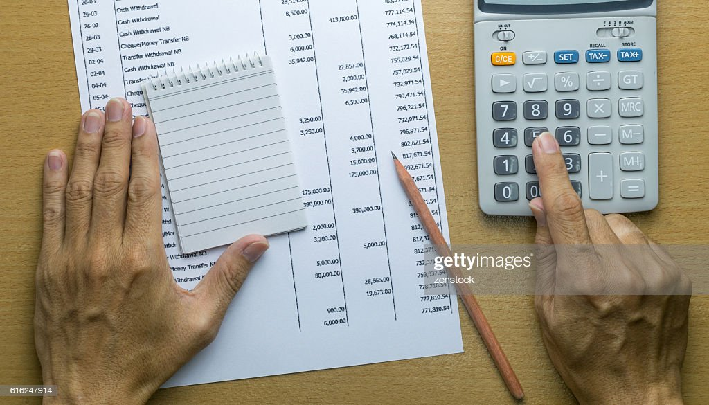 Planning monthly budget or account expenses : Stock Photo
