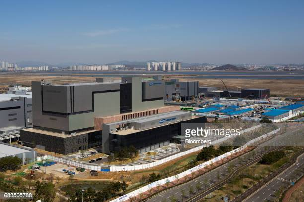 Plant 3, right, stands under construction at the Samsung BioLogics Co. Headquarters and production facilities in Songdo district in Incheon, South...