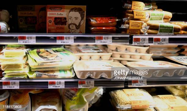 Plant based meat products are seen in a shelf of a supermarket on November 13 2019 in New York City Vegetarian alternatives to burgers and sausages...