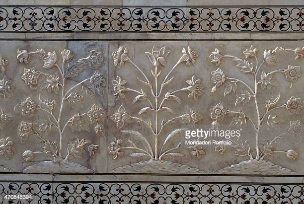 'Plant basrelief by Mughal craftsmen 16321653 17th Century white marble and gemstone inlays India Agra Taj Mahal Whole artwork view A decorative band...