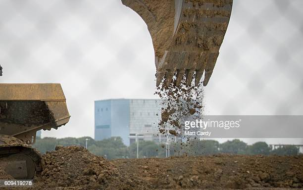 Plant machinary involved in constructing the new Hinkley Point power station operate in front of the old Hinkley Point A buildings near Bridgwater on...