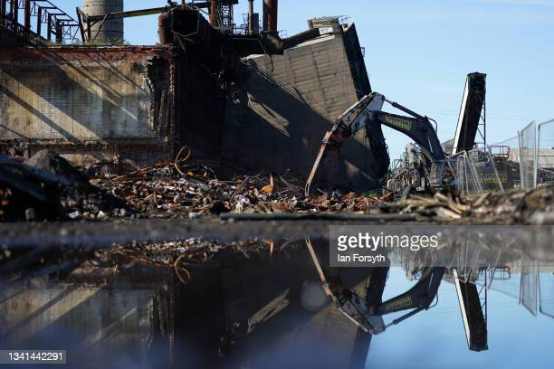 Plant machinery works on the rubble from the Gibbon Wilputte Coal bunker following the demolition of the Dorman Long Tower at Southbank on the former...