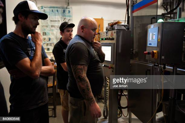 Plant manager Brian Shaeffer Sean Kottenstette director of can direction and Jeremy Connelly packaging supervisor of the Oskar Blues staff ready to...