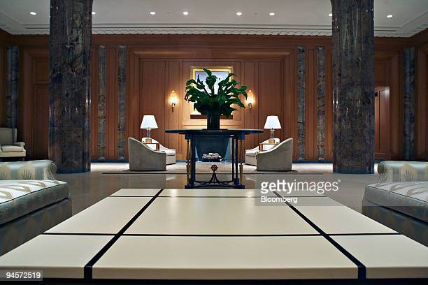 A plant sits on a table near seating areas in the lobby of 15 Central Park West in New York US on Monday Nov 5 2007