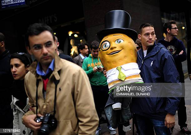 Planters Mr Peanut Mascot's head is carried by an employee after participating in a advertising mascots march as The Michelin Man was inducted in the...