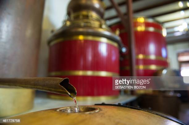 SCHNAEBELE Plants alcohol coming out from an alembic fills in a barrel at the Armand Guy distillery based in Pontarlier on January 13 2015 On January...
