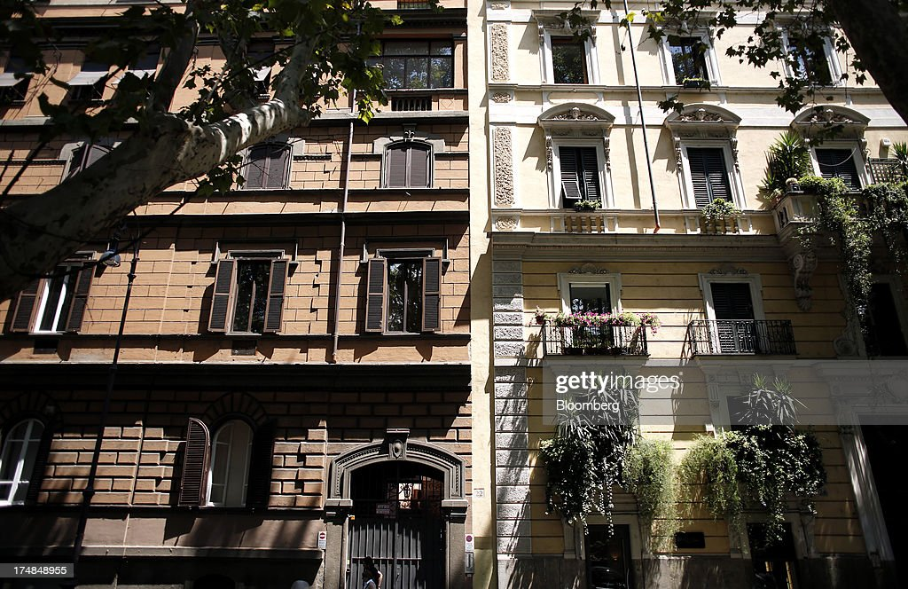 Plants grow from window boxes on the balconies of residential apartments in Rome, Italy, on Saturday, July 27, 2013. Italy's home prices are low enough to trigger an increase in purchases for the first time since 2006, though that won't lift values for at least two years, according to the Nomisma institute. Photographer: Alessia Pierdomenico/Bloomberg via Getty Images