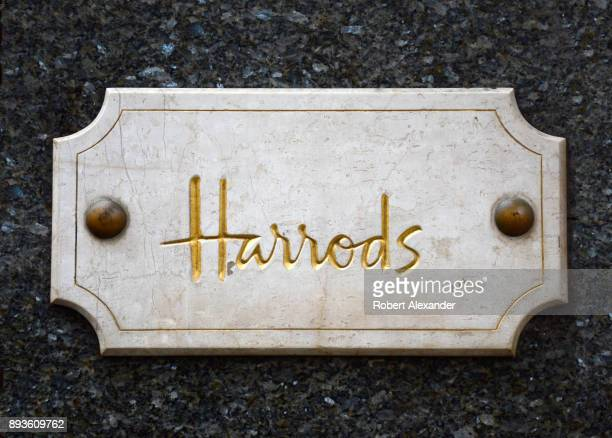 Plaque affixed to the stone facade of Harrods department store in London, England.