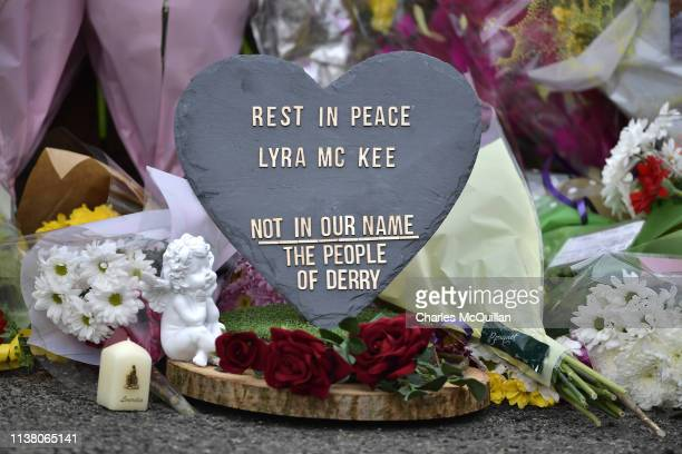 A plaque and flowers are left in tribute to journalist Lyra McKee near the scene of her shooting on April 19 2019 in Londonderry Northern Ireland...