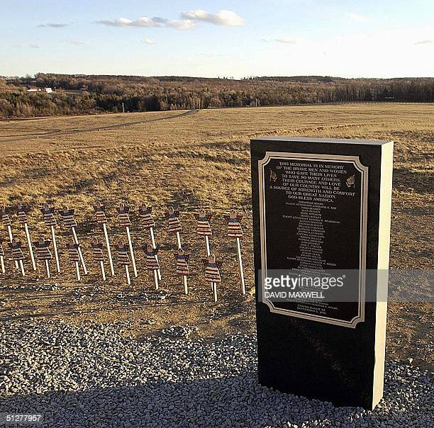 A plaque and makeshift memorial stand 10 March 2002 at a site overlooking the field where United Airlines flight 93 crashed in Shanksville...