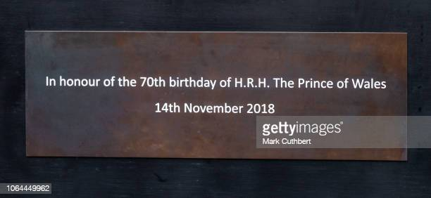 A plaque attached to a statue of a horse to mark the 70th birthday of Prince Charles Prince of Wales after the unveiling by Prince Charles Prince of...