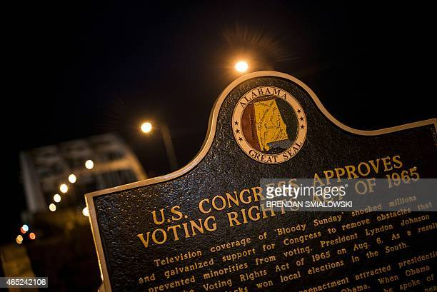 Plaque describes the 1965 Voting Rights Act at the base of the Edmund Pettus Bridge, where route 80 crosses the Alabama River, on March 4, 2015 in...