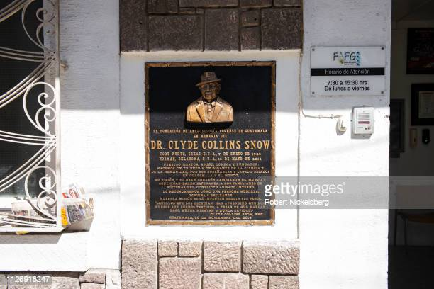 Plaque honoring Dr Clyde Collins Snow is placed on a wall outside the offices of Fundación de Antropologia Forense de Guatemala, FAFG, in Guatemala...