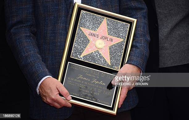 A plaque honoring the late Janis Joplin with her Hollywood 'Star' is held by her brother Michael during a posthumous Hollywood Star ceremony on...