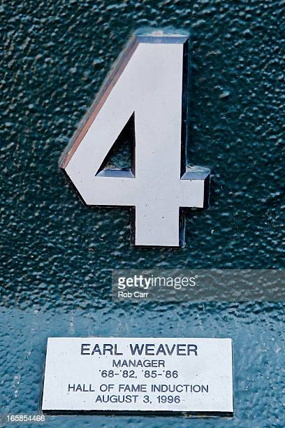 A plaque honoring the memory of former Baltimore Orioles manager Earl Weaver hangs in the dugout before the start of the Orioles and Minnesota Twins...