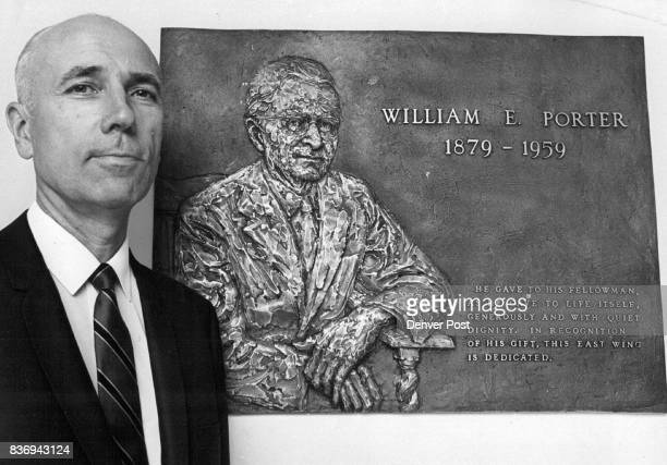 Plaque Honors Hospital Namesake Olaf T Moline administrator of Porter Memorial Hospital 2525 S Downing St Englewood stands beside a plaque honoring...