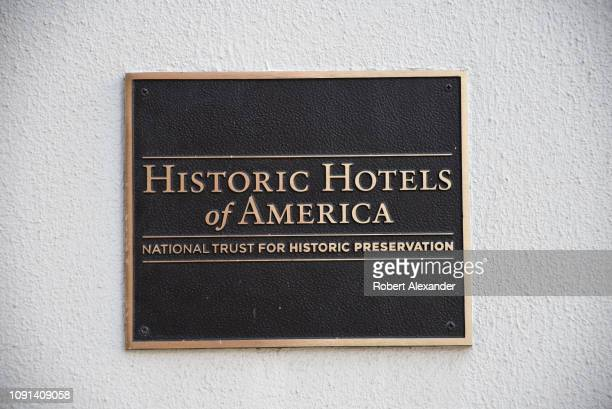 A plaque in front of the Menger Hotel in San Antonio Texas identifies the hotel as a member of the Historic Hotels of America sponsored by the...