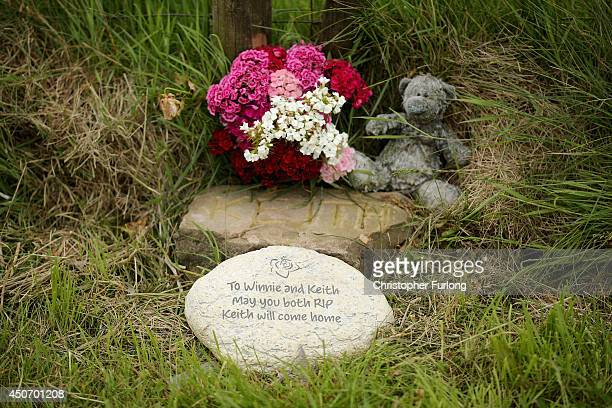 A plaque in memory of Keith Bennett and his mother Winnie Johnson sits next to floral tributes overlooking Saddleworth Moor where the body of missing...