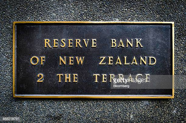 A plaque is displayed at the Reserve Bank of New Zealand headquarters in Wellington New Zealand on Thursday Dec 12 2013 New Zealand's central bank...