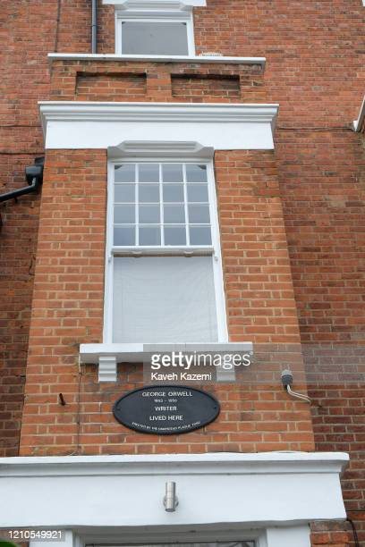 A plaque is posted above the door outside the house of famous writer George Orwell in Hampstead village on November 3 2019 in London United Kingdom