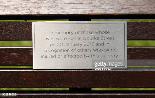 A plaque is seen on a bench to remember those affected by the Bourke Street Mall tragedy at Parliament Gardens Reserve as a memorial is held for...