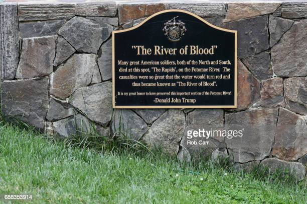 A plaque is shown near the 16th tee and 15th green during Round 1 of the Senior PGA Championship at Trump National Golf Club on May 25 2017 in...