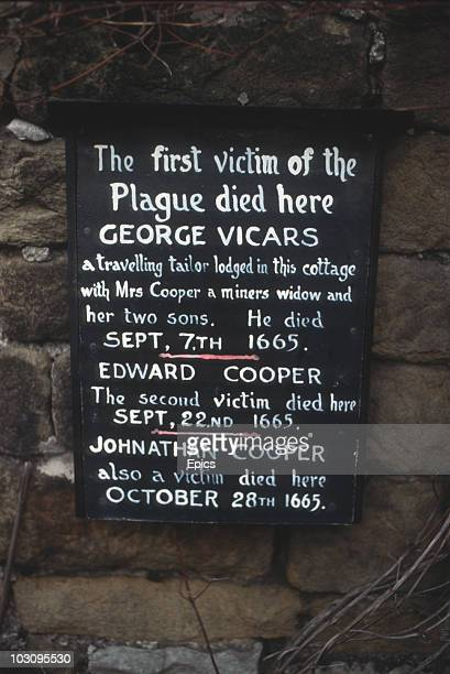 A plaque marking the spot where the first victim of the plague George Vicars lived in the village of Eyham Derbyshire circa 1975 It is said that...